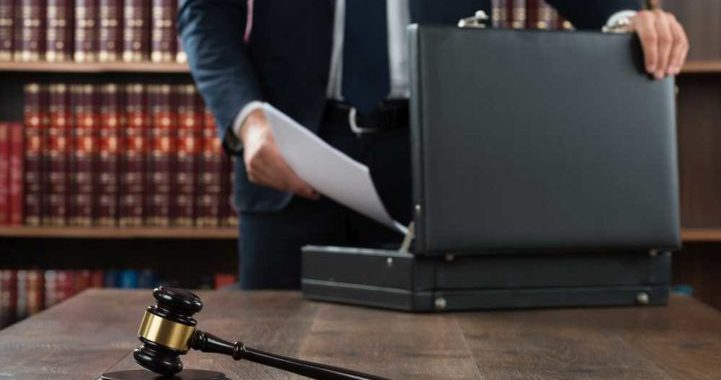 Lawyer Putting Documents In Briefcase